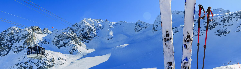 Ski winter season - mountains, cable car and ski equipments on s